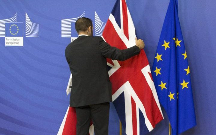 79208108_an_employee_at_the_european_commission_adjusts_a_british_flag_ahead_of_the_meeting_between-large_trans-abdaf1kcjzbra1vshprjk8g